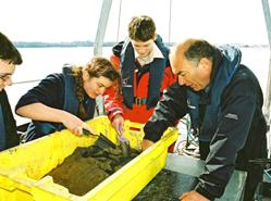 1. Year 10 students investigating sea bed sediments with Dr Simon Boxall on the School of Ocean and Earth Science research training vessel Callista