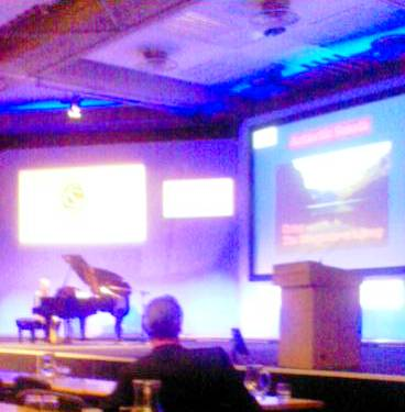 Kevin Jones plays the Sonata while Nick Petford (foreground) listens and the associated graphics play over the screen