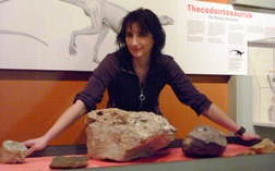 Judyth Sassoon, an MSc student at Bristol, leans over the exhibit of the Bristol Dinosaur. Phot: Ian Randall