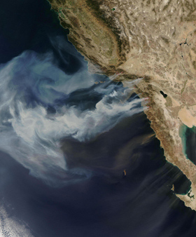 Smoke plumes from southern California wildfires billowing out over the Pacific Ocean