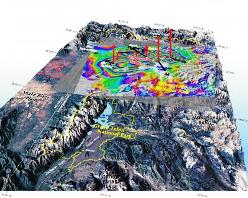 Digital elevation map of Yellowstone and Grand Teton national parks overlaid with elevation change data (colours) from Global Positioning System receivers and satellite measurements. The red arrows pointing up represent uplift of the caldera.