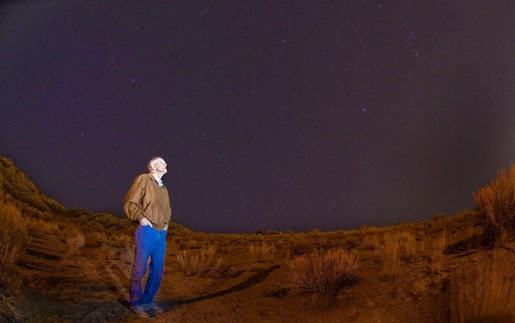 Dick Spalding examines the night sky (Photo by Randy Montoya)