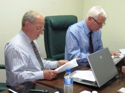 Gaskarth (left) and John Powell pore over course provision details