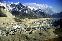 Fig. 4. One of many Himalayan glaciers losing mass, Khumbu Glacier, Nepal. The uneven glacier surface mantled by debris. Substantial downwasting evident from the Little Ice Limit, defined by fresh moraine scar across middle of picture (M Hambrey)