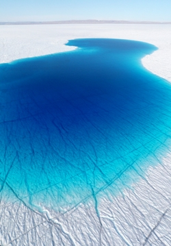 Fig. 6. Seasonal meltwater lake on the Greenland Ice Sheet. Note the network of supraglacial channels flooded by the lake. Pic - Alun Hubbard