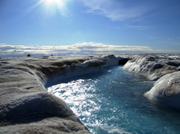 Fig. 7. Large supraglacial stream on the surface of the Greenland Ice Sheet. Photo: Alun Hubbard