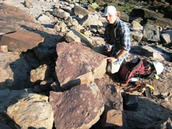 Randy Miller of the Saint John Museum, New Brunswick with two slabs covered in early Pennsylvanian fossil tracks at Tynemouth Creek