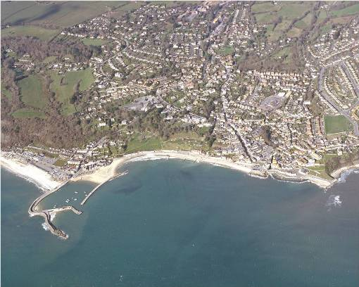 1. Aerial photograph of Lyme Regis showing the central area of landslipping. The Cobb, Lyme's ancient harbour, is seen to the west. Copyright permissions, West Dorset District Council.