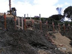 Slopes and new sea wall were stabilised using 110 bored piles reinforced by steel tubes - and in some cases beams, and also using steel tube soil nails