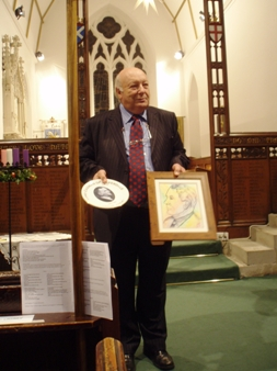 Lord Cadman the third (grandson) receives a memorial plate and a portrait of his grandfather done/organised by local schoolchildren of Silverdale. Photo: Shirley Torrens.