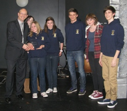 Paul Maliphant (Vice President) presents the trophy to the winning team from Whitchurch High.