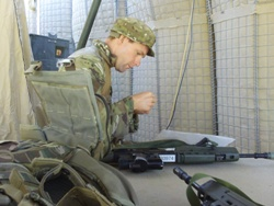 Environment Agency Officer Richard Hull Cleaning his Rifle at a Forward Operating Base.