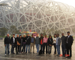 Young Earth scientists - and Executive Secretary Edmund Nickless (left) - gather in Beijing