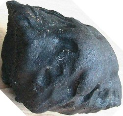 Figure 2. A recovered fusion crust coated and oriented mass of Villalbeto de la Peña Spain.