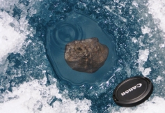 Meteorite entombed in ice, Tagish Lake. Courtesy, Alan Hildebrand, University of Calgary & Peter Brown, University of Western Ontario http://aquarid.physics.uwo.ca/~pbrown/tagish/