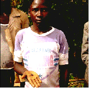 The locky boy of Mbale, with the L6 condrite fragment that landed on his head.