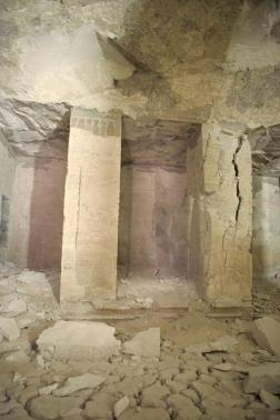 Previously flooded area shows cracking on mud floor, pillars breaking and ceiling falling in.