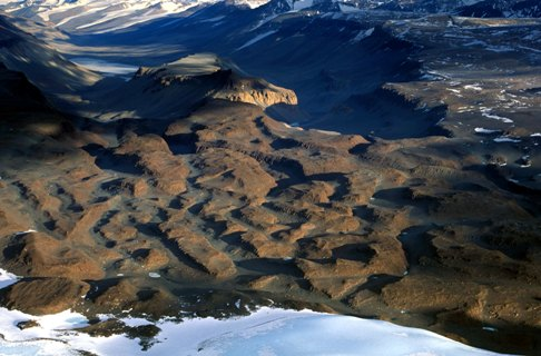 The Laybrinth, Upper Wright Valley, Antarctic Dry Valleys in East Antarctica. Deep (>100 m) channels incised into hard bedrock by the action of massive outburst flooding from one or more subglacial lakes. . Courtesy, David Sugden and George Denton.