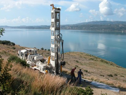Test borehole drilled to a depth of 122m (400 feet) to determine whether surface rockfall continues below sea level