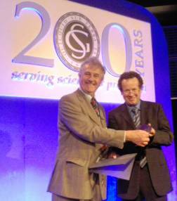 Dr Fortey (left) receives the von Buch Medal from Dr Rolling