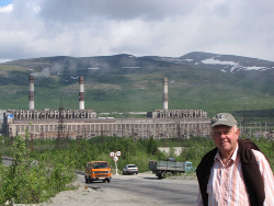 The smelter at Apatity with the author (Glasby) pictured in the foreground. The smelter complex extends a long way into the background. Only the smelter on the left is in action.
