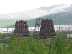 The cooling towers at Apatity with the smelter and Khibiny Mountains in the background.