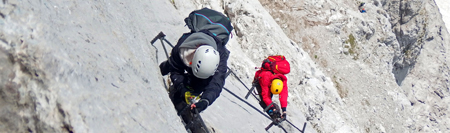 Two people mountain climbing