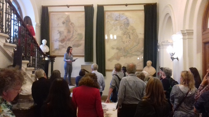 A full crowd beneath the William Smith and Greenough maps