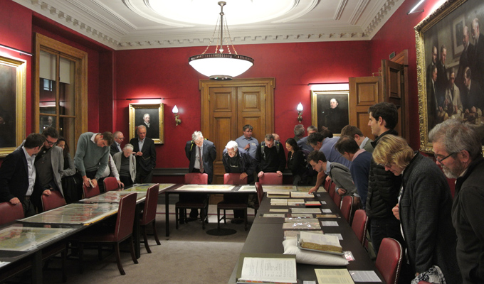 Visitors enjoy the archive and map exhibition in the Council Room
