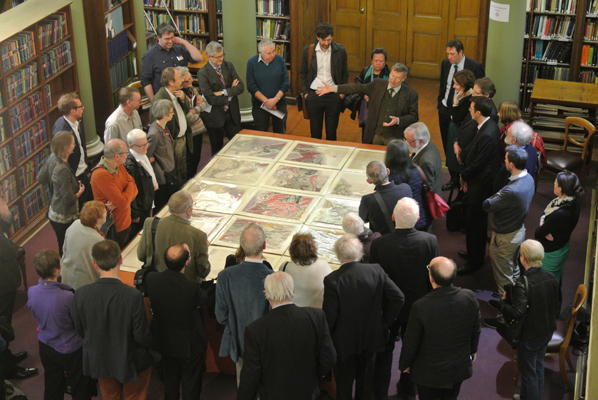 Visitors view the newly discovered copy of William Smith's map, with Tom Sharpe on hand to explain the history of its creation